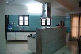 Residence : modern Kitchen by AM Associates
