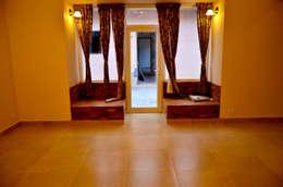 Streamside Homes: modern Living room by Vitrag Group