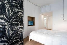 Dormitorios de estilo escandinavo por Tommaso Giunchi Architect