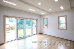 Salas de estilo clásico por 지성하우징