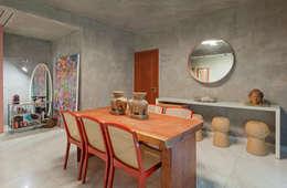 Sala de jantar: Salas de jantar industriais por Jacqueline Ortega Design de Ambientes