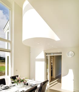 double height dining space of contemporary home in NI: modern Dining room by Jane D Burnside Architects