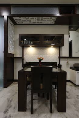 Dinning Area: modern Dining room by RAVI - NUPUR ARCHITECTS