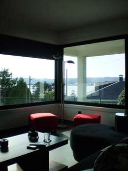 ห้องนั่งเล่น by Intra Arquitectos