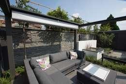 Jardines de estilo moderno por GroenerGras Hoveniers Amsterdam