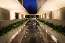 Modena condominium Design:  โรงแรม by D' Architects Studio