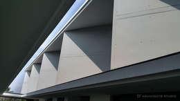 Modena condominium Design:  พื้นและกำแพง by D' Architects Studio