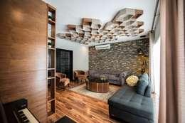 Salas de estilo industrial por ESTUDIO TANGUMA