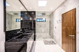 Baños de estilo moderno por ESTUDIO TANGUMA