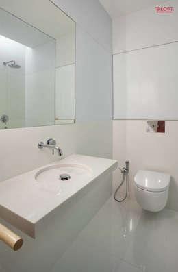Baños de estilo minimalista por B.loft