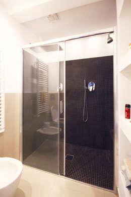 Baños de estilo minimalista por Andrea Orioli
