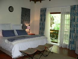 Guest bedroom in Blues: country Bedroom by SOJE Interior, Design and Decor PTY (Ltd)