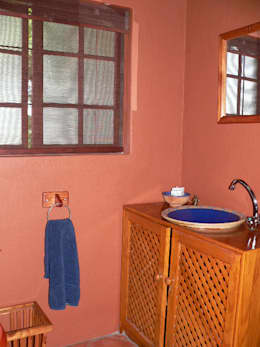 Adding decor and blinds to the guest bathroom: country Bathroom by SOJE Interior, Design and Decor PTY (Ltd)