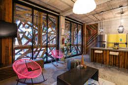 tropical Living room by MORADA CUATRO