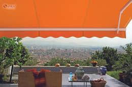 Balcones y terrazas de estilo  por Vertilux México