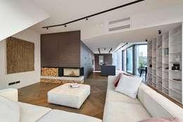 Salones de estilo moderno de FADD Architects