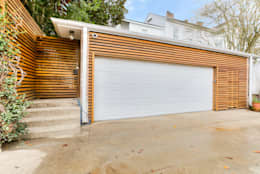 Garajes de estilo ecléctico por studioWTA