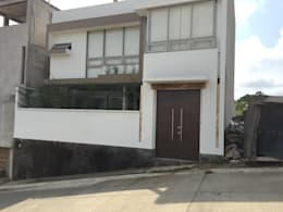 Fachada Posterior: Casas de estilo moderno por Cahtal Arquitectos