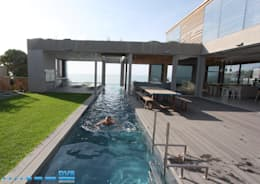 Piscinas de estilo  por DV8 Architects