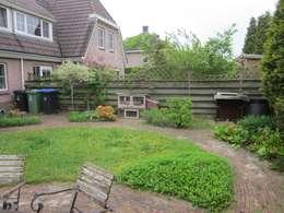 renovatie achtertuin: moderne Tuin door GroenerGras Hoveniers