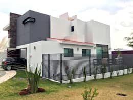 Casas de estilo minimalista por Base-Arquitectura