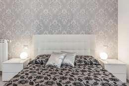 Camera con parete vintage: Camera da letto in stile in stile Moderno di Facile Ristrutturare