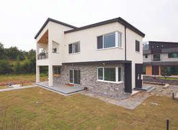 Casas de estilo moderno por (주)그린홈예진