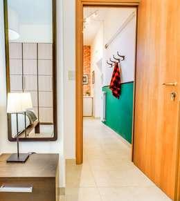 Projekty,  Korytarz, hol i schody zaprojektowane przez Progetti e caffè