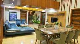 Bungalow : modern Dining room by Shadab Anwari & Associates.