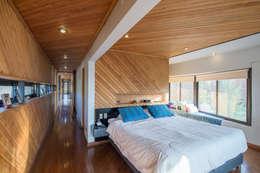 Casa Rosales Quijada: Dormitorios de estilo moderno por GITC