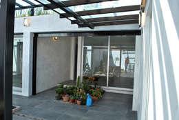 LOCAL: Espacios comerciales de estilo  por Novhus Oficina de Arquitectura