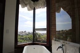 Baños de estilo rústico por Barros e Zanolini Arquitetura e construção