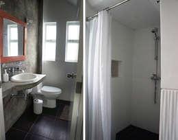 Baños de estilo rústico por malu goni