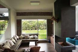 Salas / recibidores de estilo  por malu goni