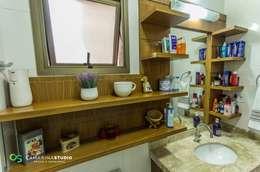 Baños de estilo rústico por Camarina Studio