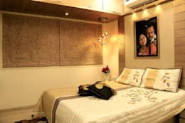 MR HARESH RESIDENCE: modern Bedroom by PSQUAREDESIGNS
