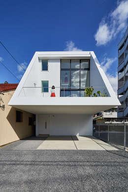 Case in stile in stile Moderno di 武藤圭太郎建築設計事務所