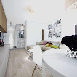 Klimatyczne M2: styl , w kategorii Salon zaprojektowany przez Studio Aranżacji Agnieszka Adamek