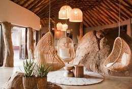 Madikwe Hills informal lounge:  Hotels by Nowadays Interiors