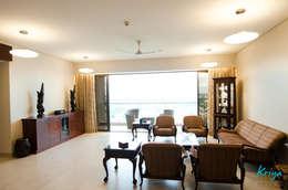 Pebble Bay: classic Living room by KRIYA LIVING