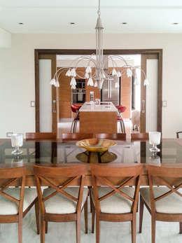 Casa en Rumencó: Comedores de estilo moderno por id:arq