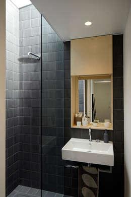 No. 49: modern Bathroom by 31/44 Architects