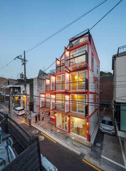Projekty, nowoczesne Domy zaprojektowane przez Design Guild