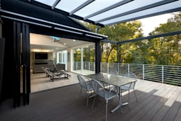 Cache House:  Patios & Decks by KUBE Architecture