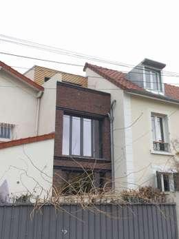 COLOMBES - GABRIEL: Maisons de style de style Moderne par Atelier d'architecture ASTA