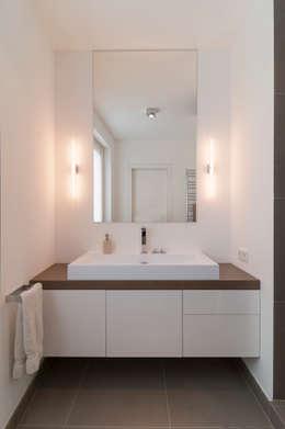 modern Bathroom by Egg and Dart Corporation GmbH & Co.KG   München
