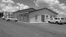 the existing office & maintenance building before our alterations & additions:  Office buildings by Till Manecke:Architect