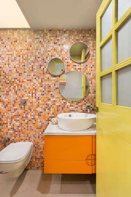 Colourful Wall-Tiled Washroom: modern Bathroom by The design house