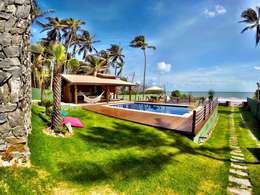 Casas de estilo tropical por DC PROJETOS