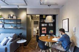 Apartamento Soho: Salas de jantar industriais por K+S arquitetos associados